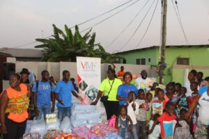 VMF Team in a group picture with children of Enough Grace Foundation