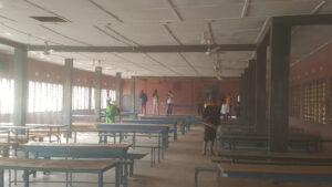 A Gun Sprayer disinfecting Sunyani Senior School dinning hall