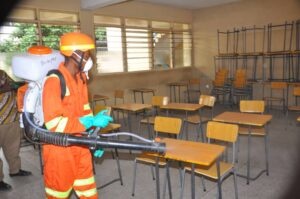 A Gun Sprayer disinfecting one of the classrooms of the universities