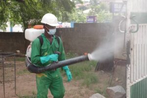 Gun Sprayer disinfecting one of the dormitories of Ahafoman Senior High School