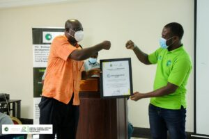 A member of Youth in Natural Resources and Environmental Governance (Youth-NREG) Platform receiving a Citation